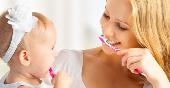 brushing mom and daughter