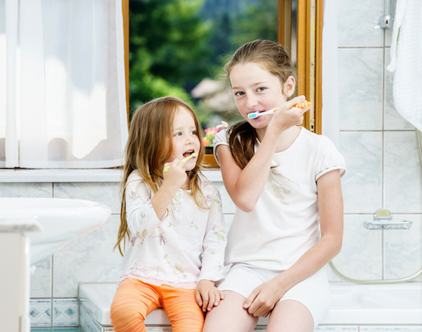 girls brushing dental home copy